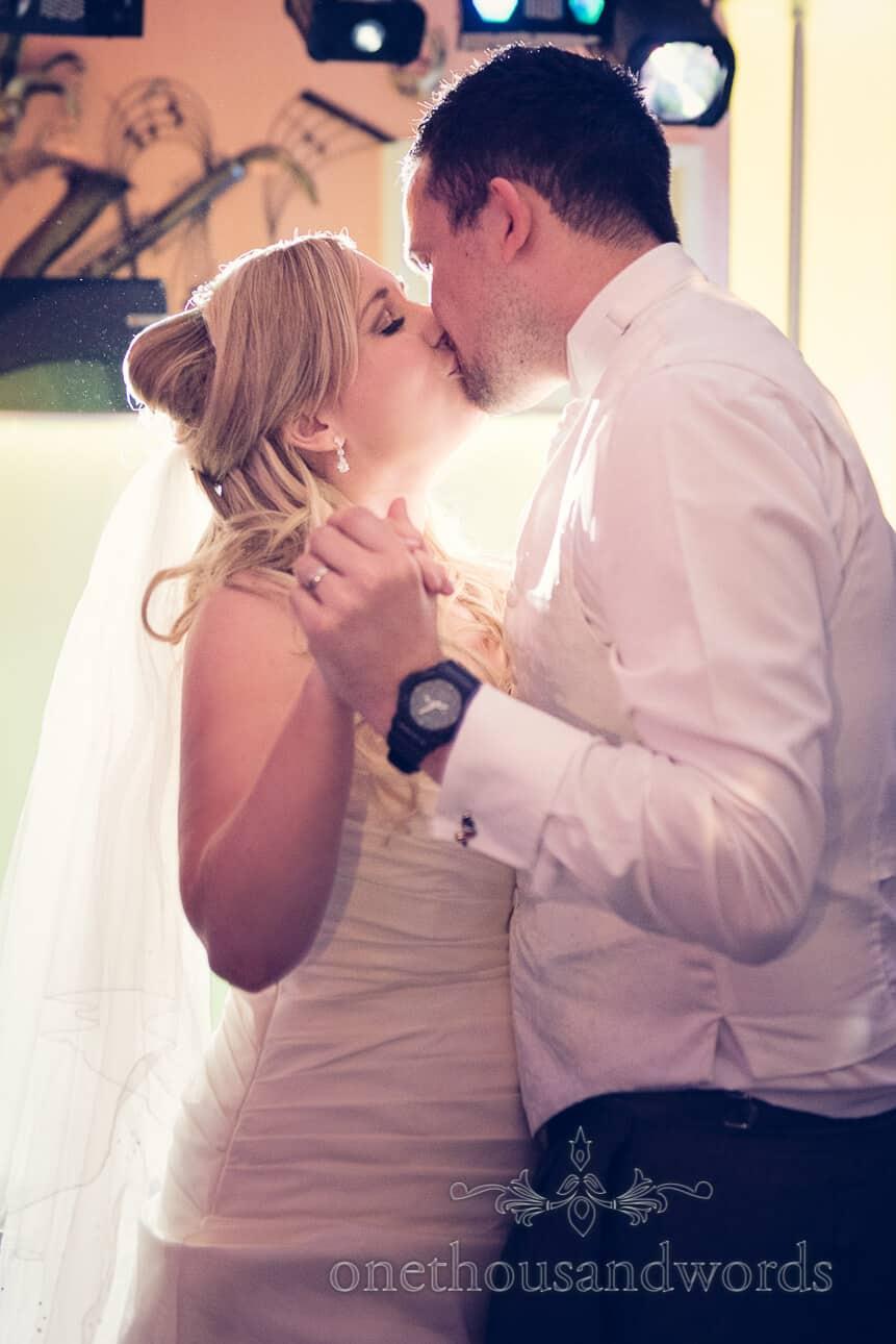 First dance kiss on dance floor