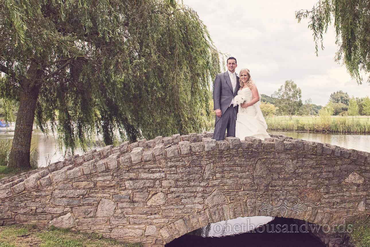 Wedding couple on bridge at Dudsbury Golf Club Wedding