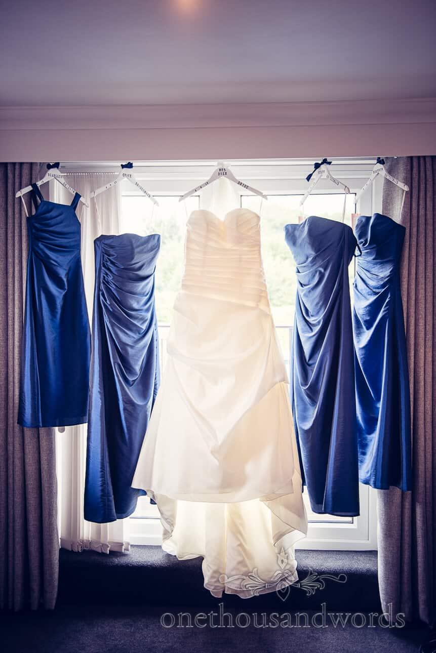 Wedding Dresses hang in window