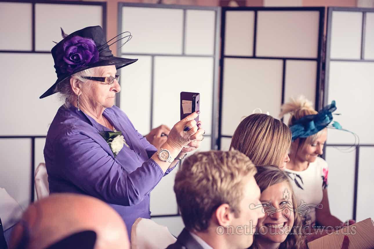 Wedding guest take photo at Dudsbury Golf Club Wedding