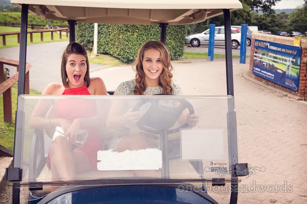 Wedding guests in a golf buggy at Dudsbury Golf Club Wedding