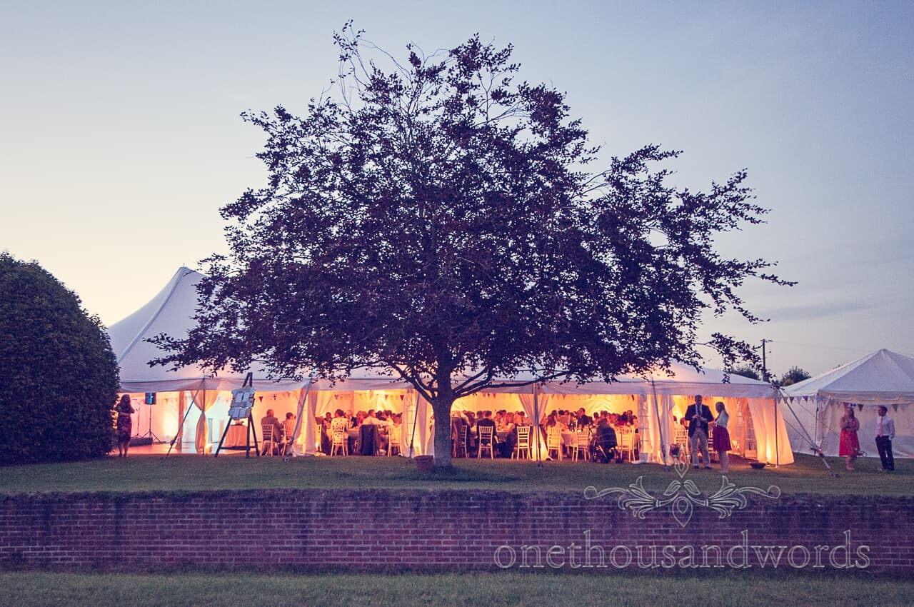 Wedding Marquee Glowing from Inside on Wedding Evening