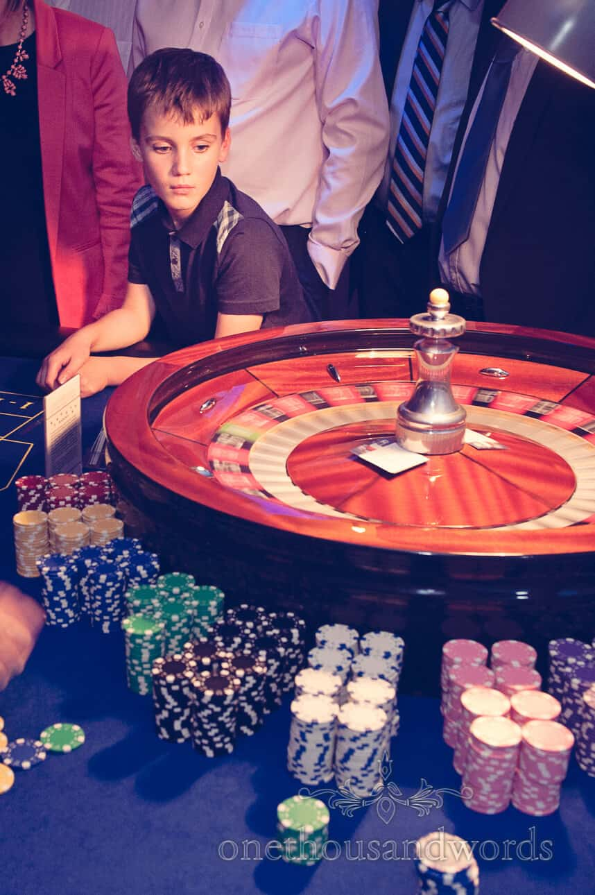 Young wedding guest at wedding casino talble