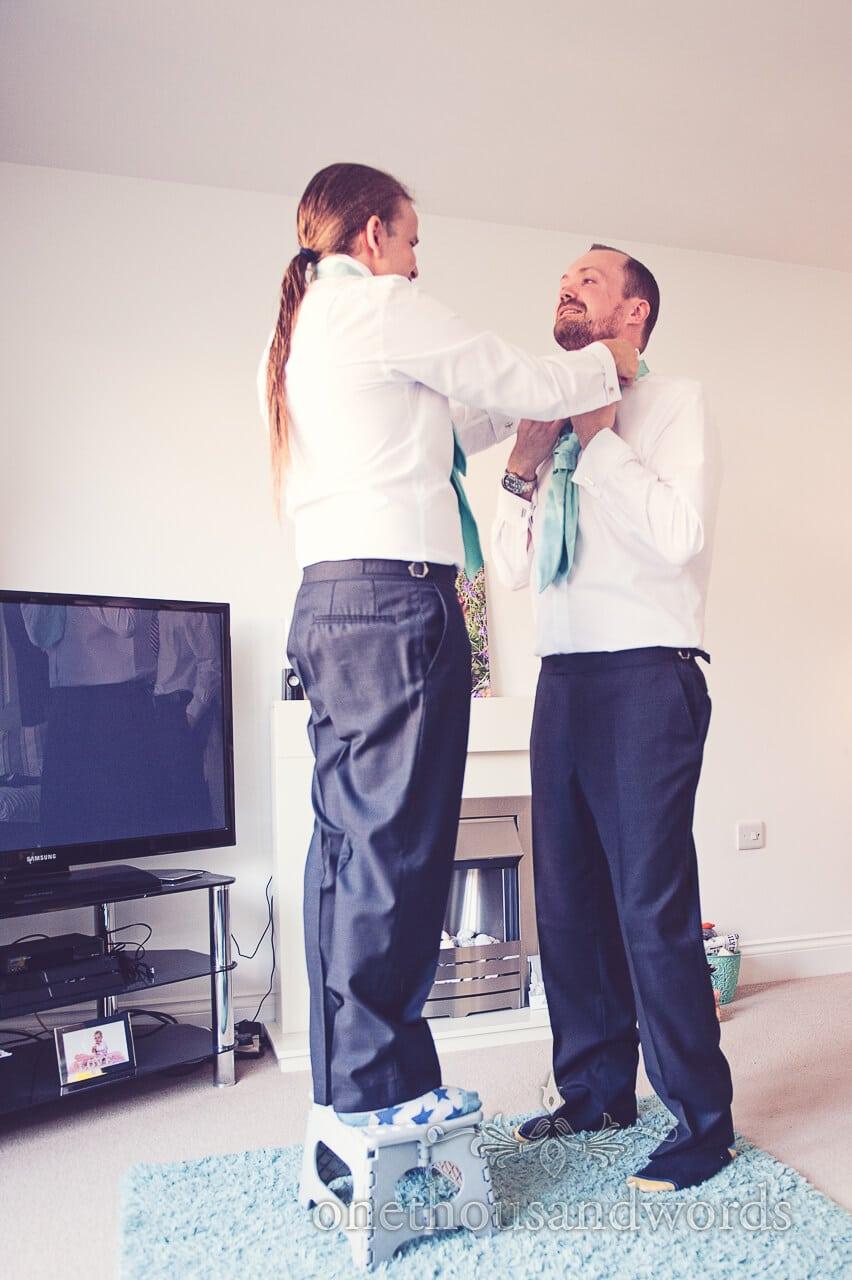 Best man helps Groom on wedding morning