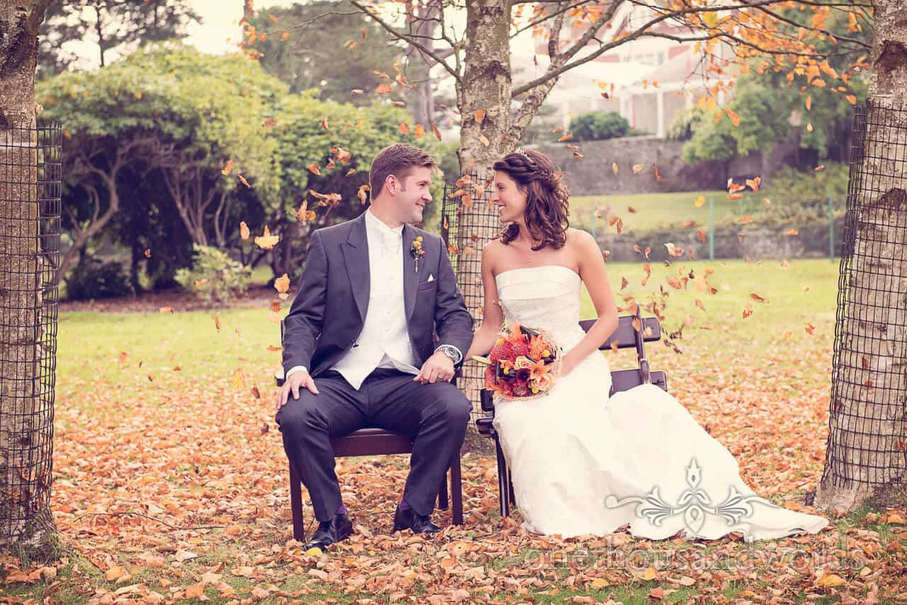 Bride and Groom seated in garden