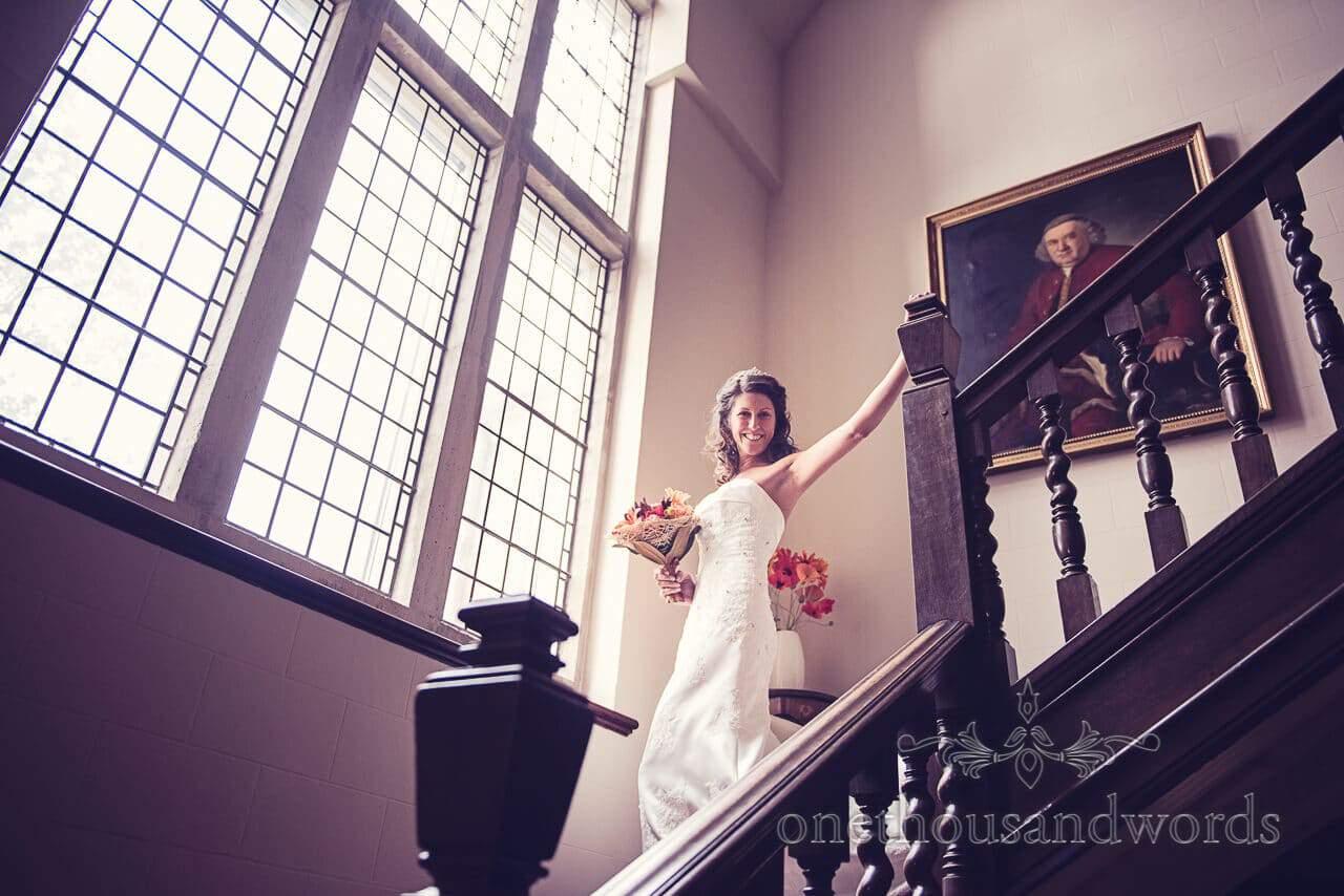 Bride descends staircase at Studland Bay House Wedding