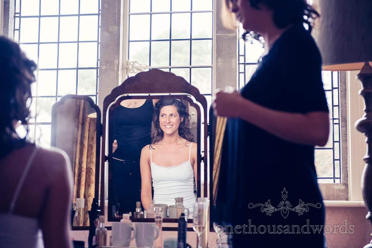 Bride in the mirror at Studland Bay House Wedding