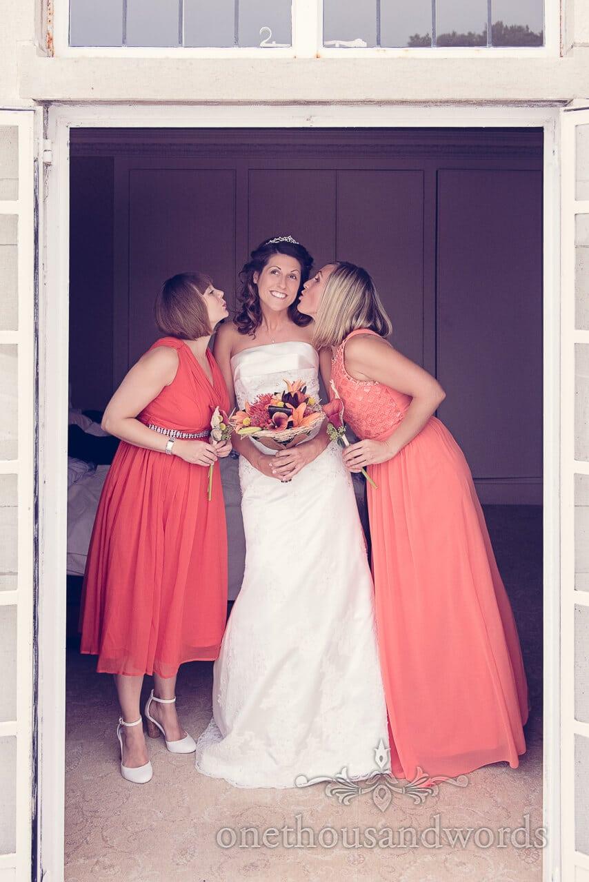 Bridesmaids kiss Bride at Studland Bay House Wedding