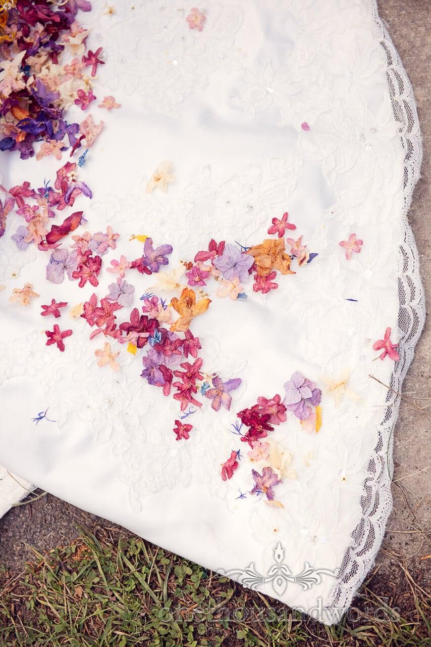 Confetti on dress at Studland Bay House Wedding