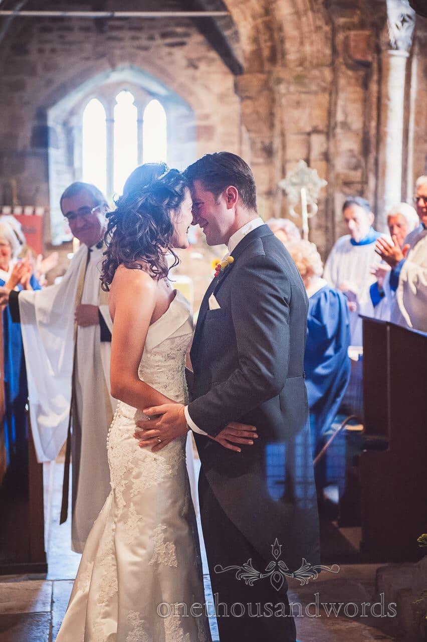 Couple embrace at Studland Bay House Wedding