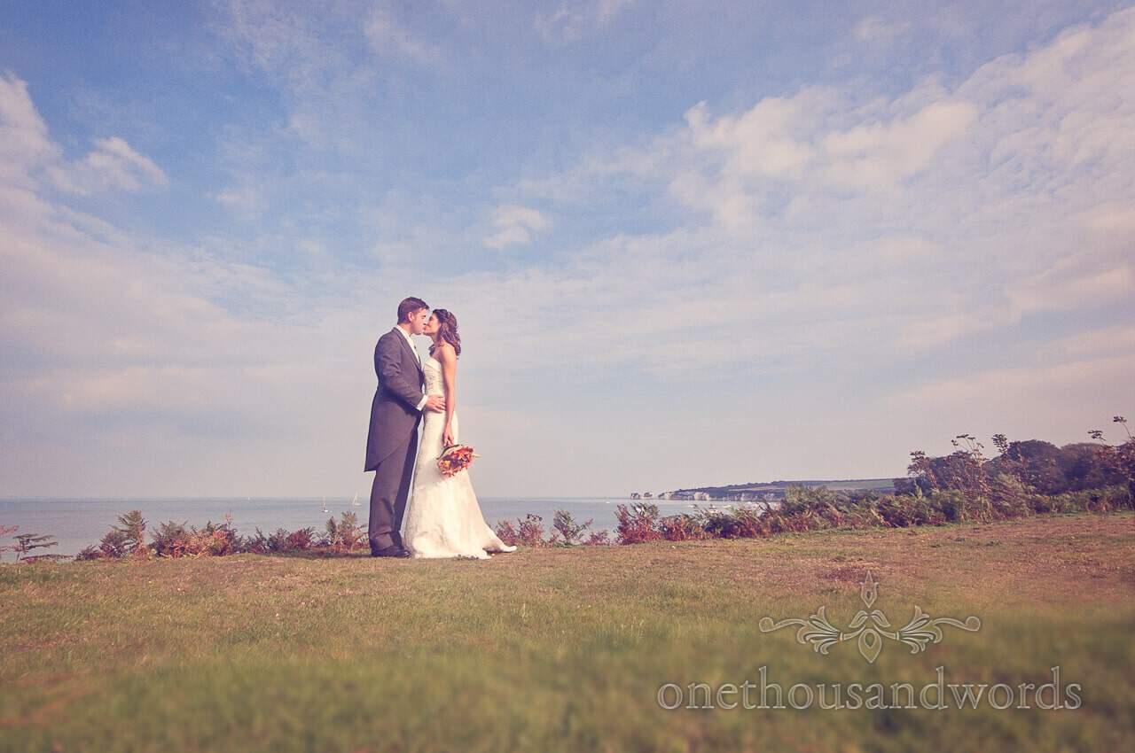 Couple Kiss at Studland Bay House Wedding