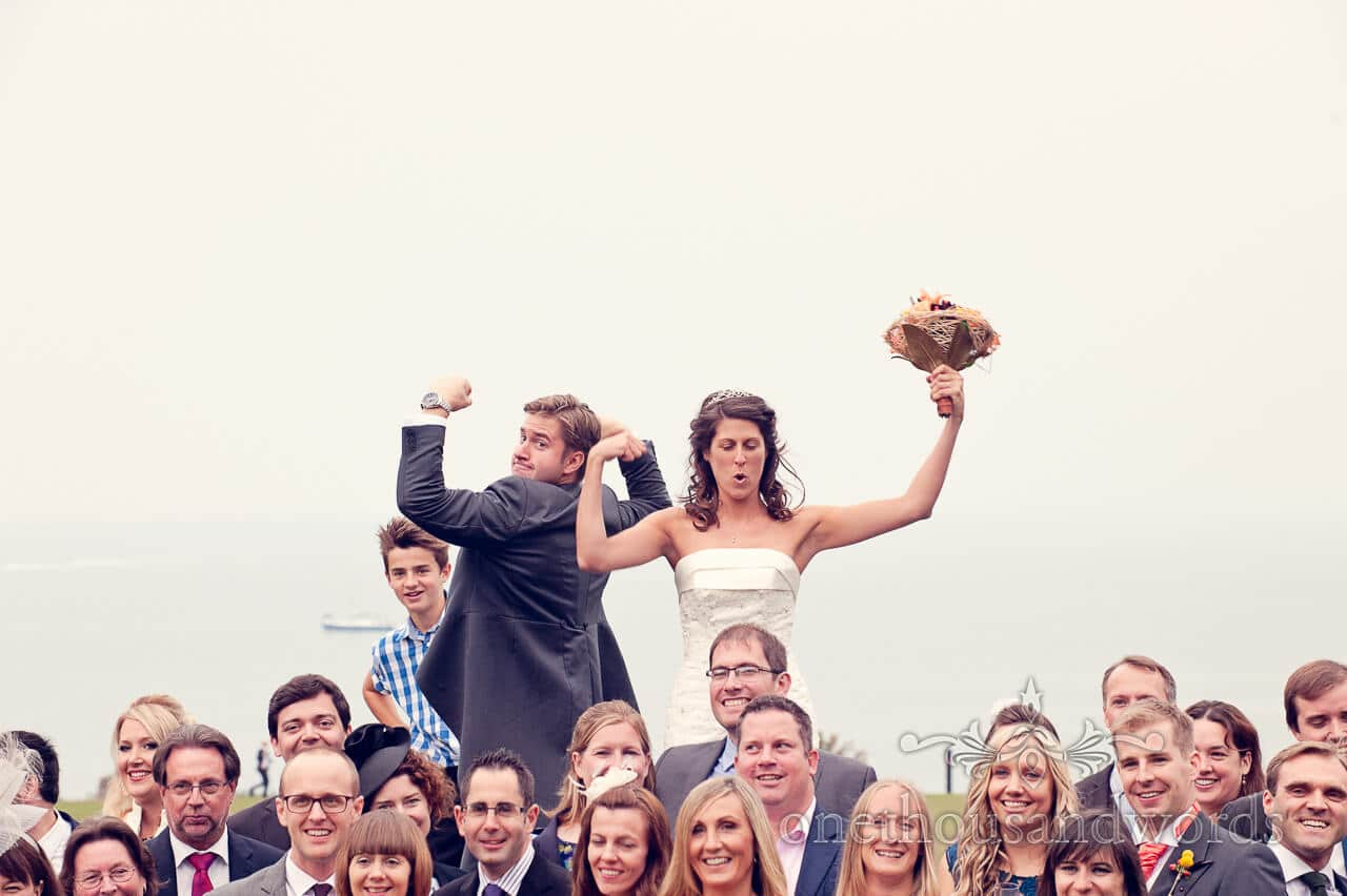 Couple pose with guests at Studland Bay House Wedding