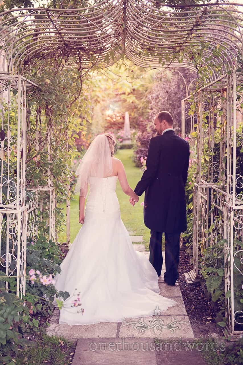 Couple under arch at Parley Manor Wedding