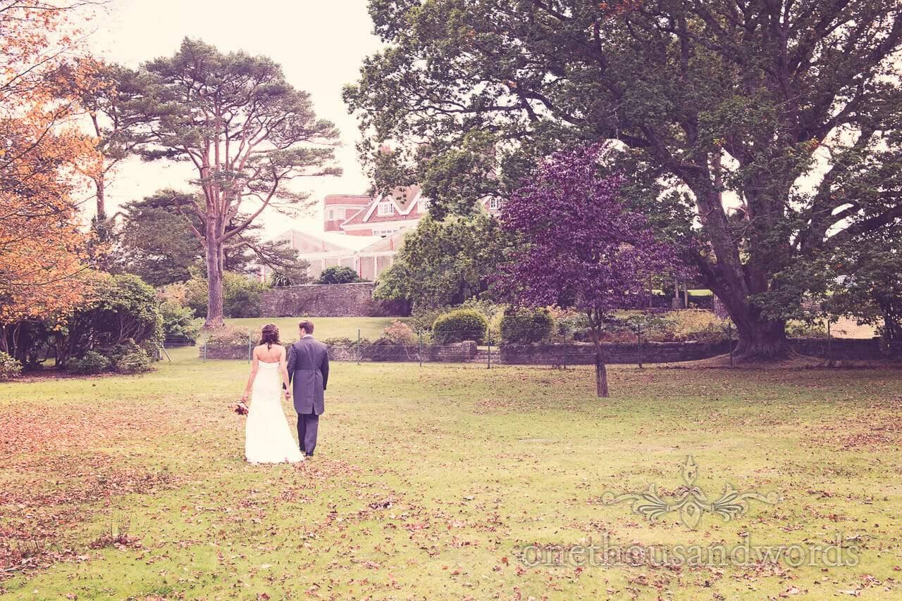 Couple walk away at Studland Bay House Wedding
