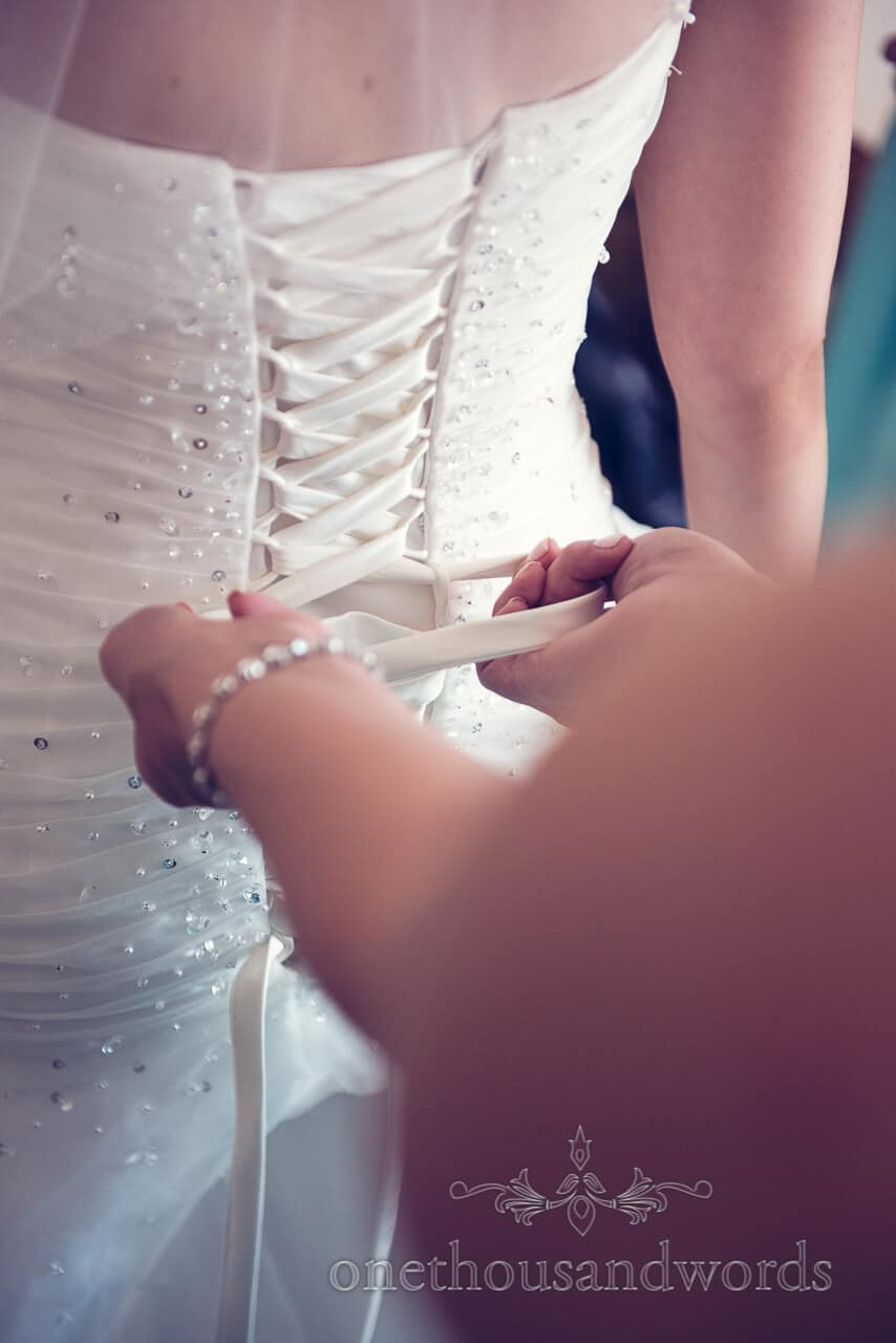 Dress being done up before Parley Manor Wedding