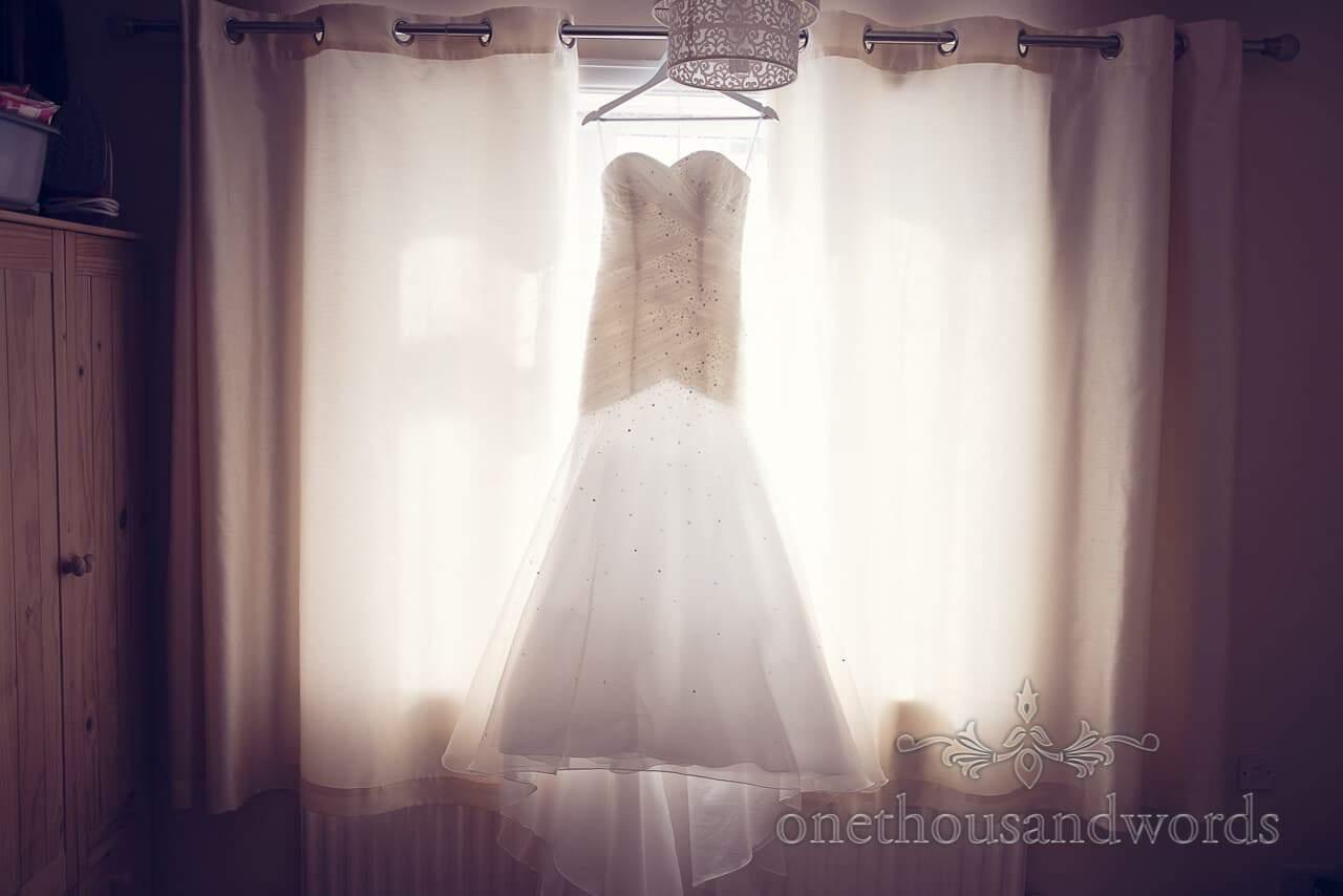 Dress in Window before Parley Manor Wedding