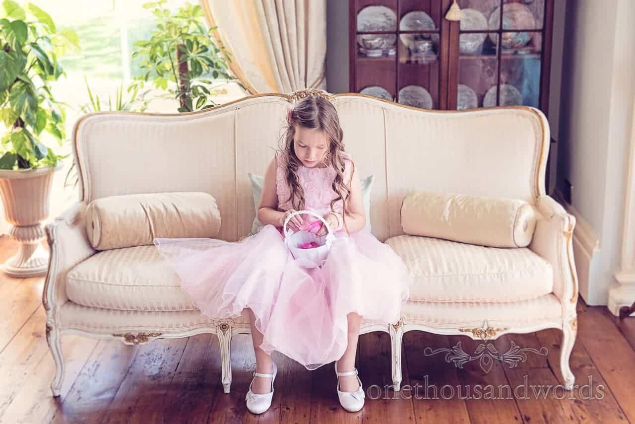 Flower girl waits at Parley Manor Wedding