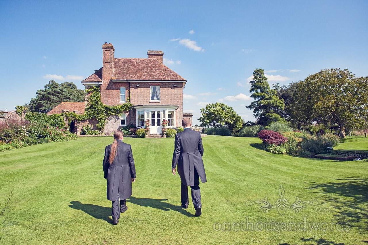 Groom and Best Man in garden at Parley Manor Wedding