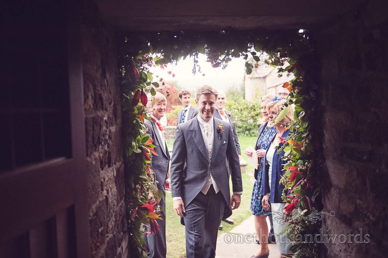Groom enters the church Studland Bay House Wedding