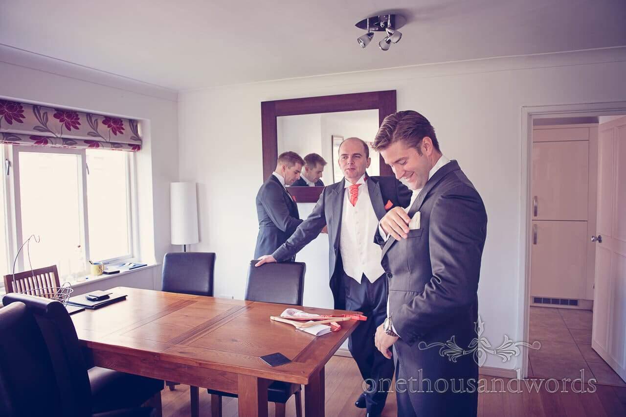 Groom prepares before Studland Bay House Wedding
