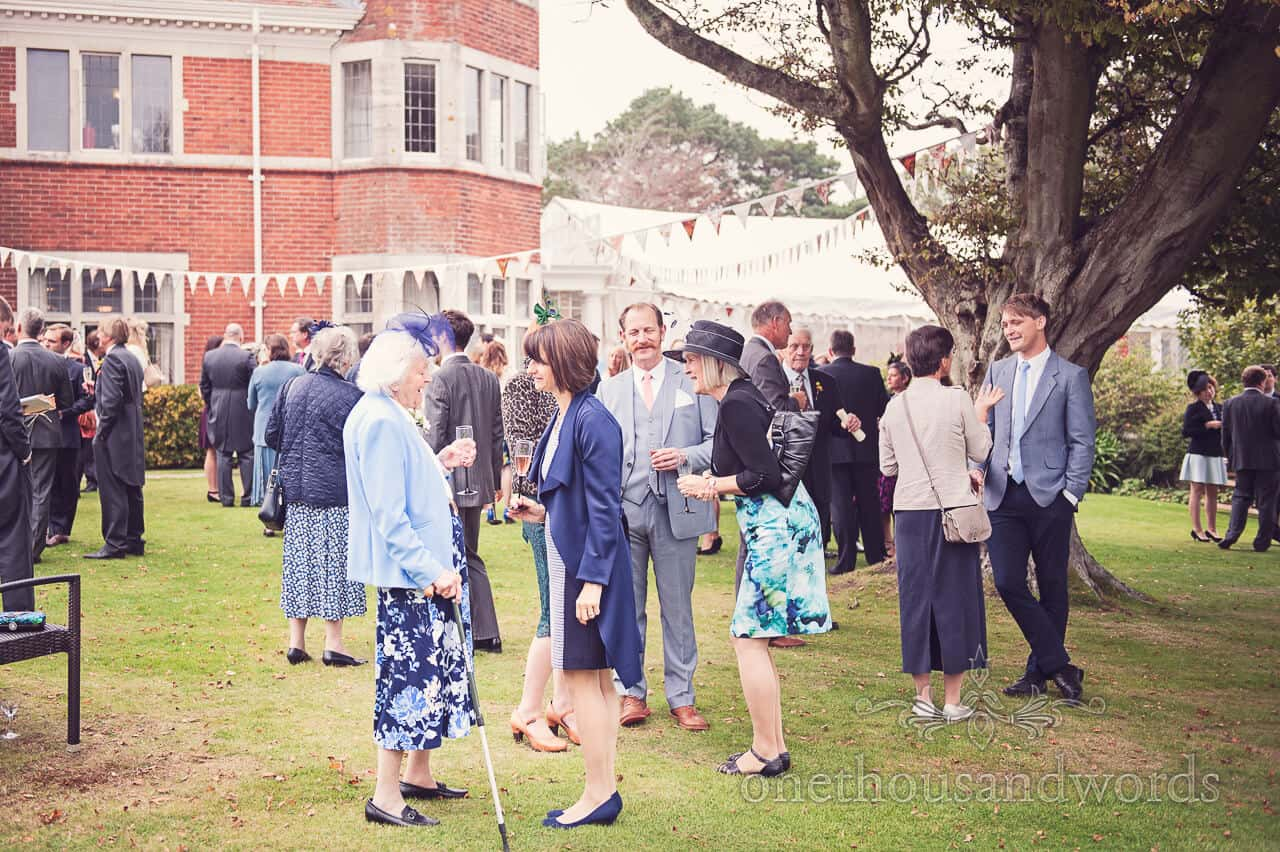 Guests on lawn at Studland Bay House Wedding