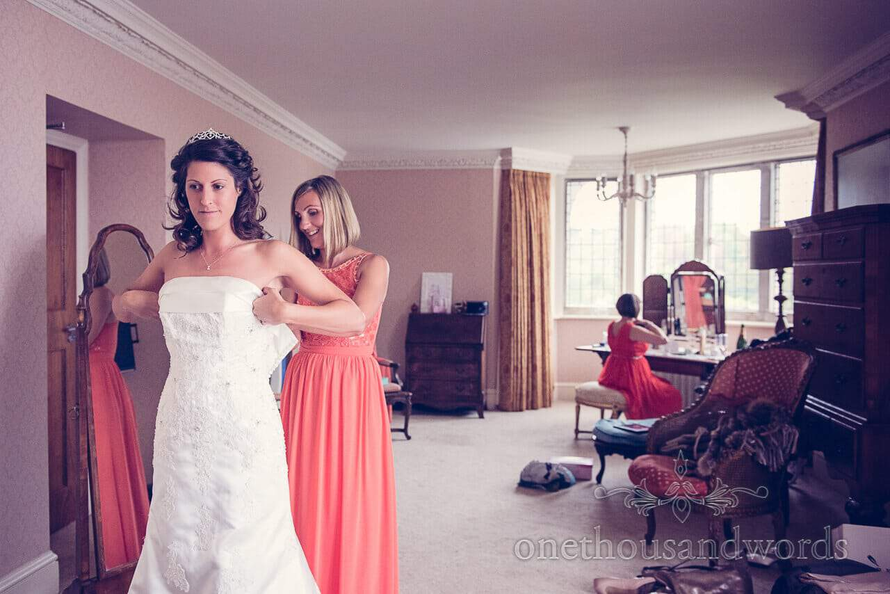 Into the dress at Studland Bay House Wedding