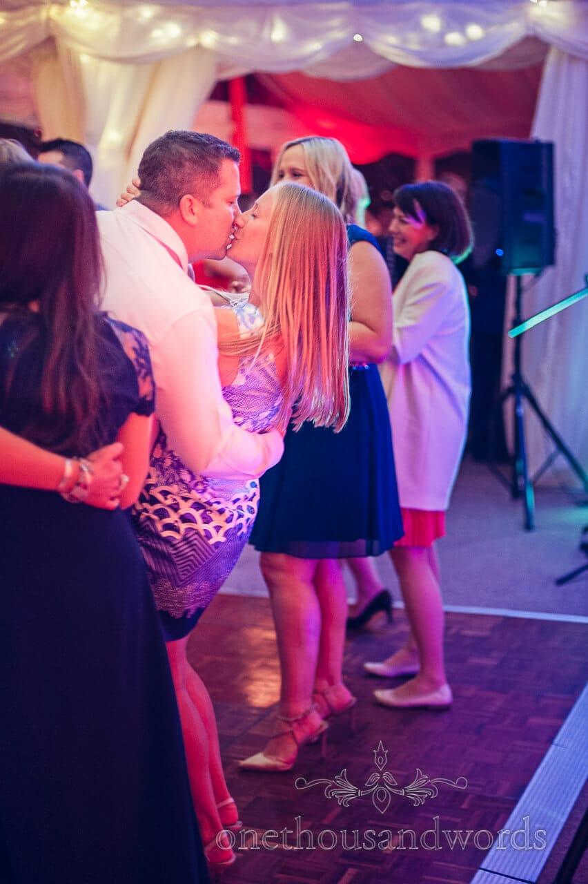 Kissing guests at Studland Bay House Wedding
