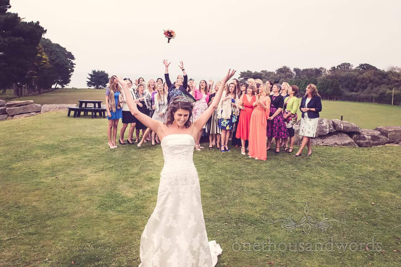 Throwing the bouquet at Studland Bay House Wedding