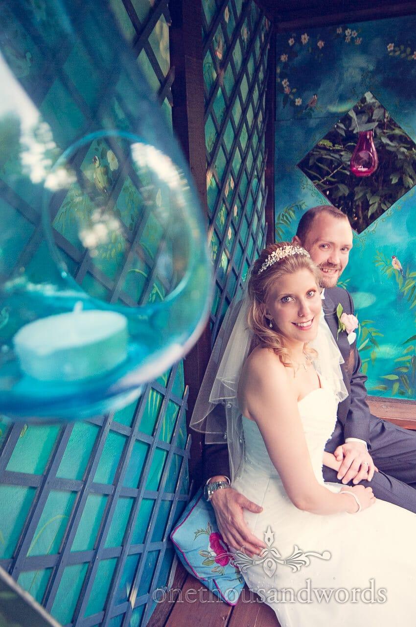 Wedding couple sit at Parley Manor Wedding