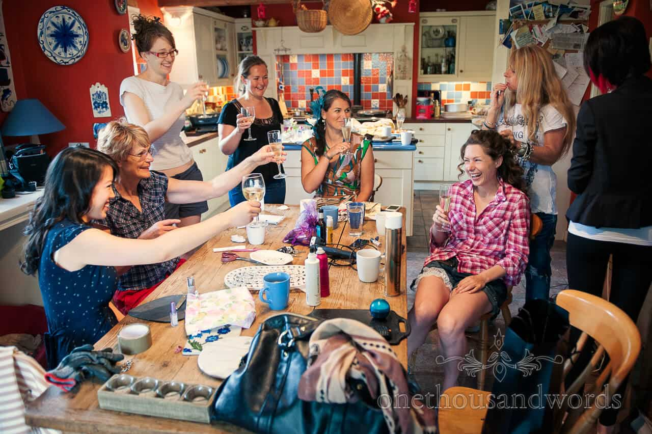 bridal party drinking champagne on wedding morning