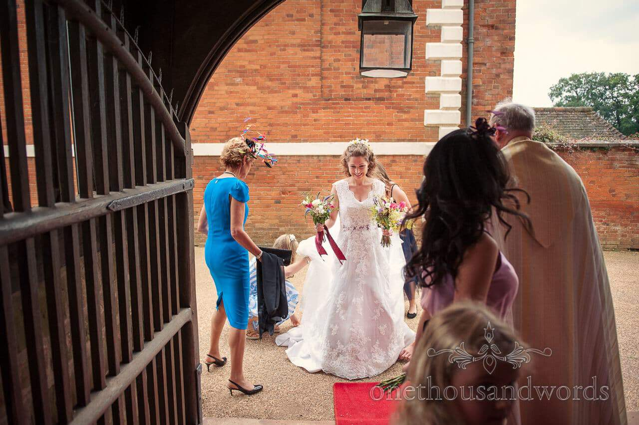 Bride about to enter countryside church wedding ceremony