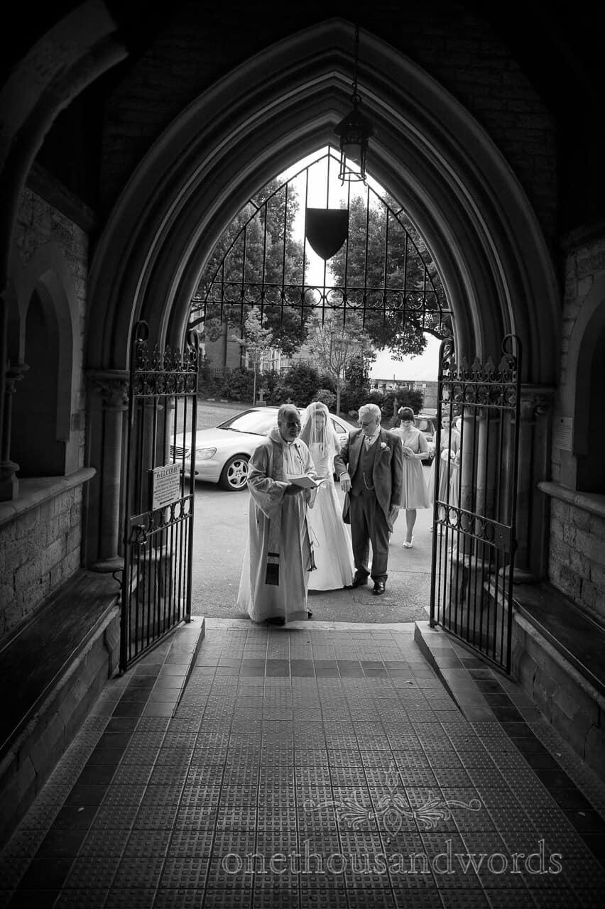 Bride and Father enter St Peters church wedding ceremony in Bournemouth