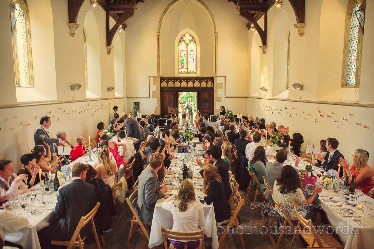 Bride and groom enter wedding breakfast in Church at Plush Manor