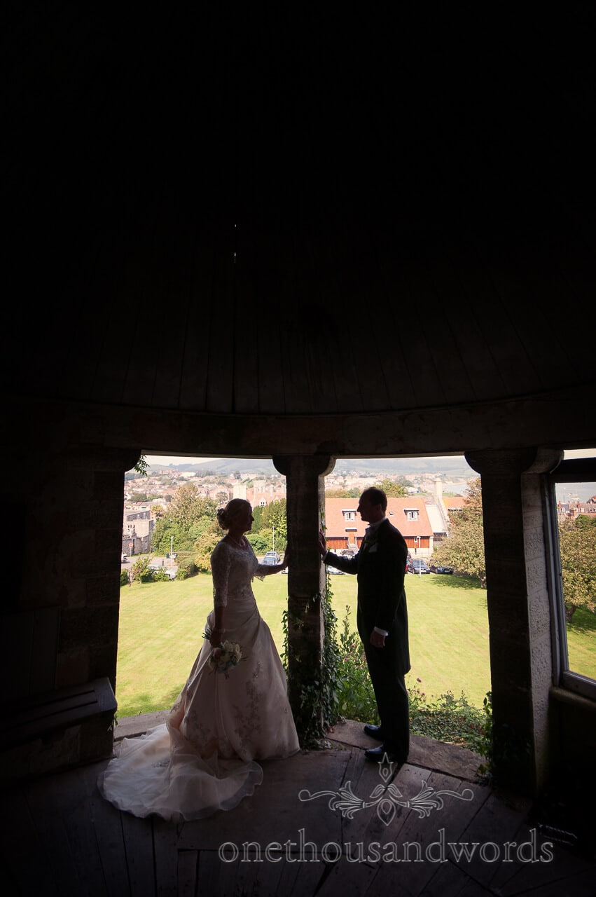 Bride and groom in silhouette at Purbeck House Hotel