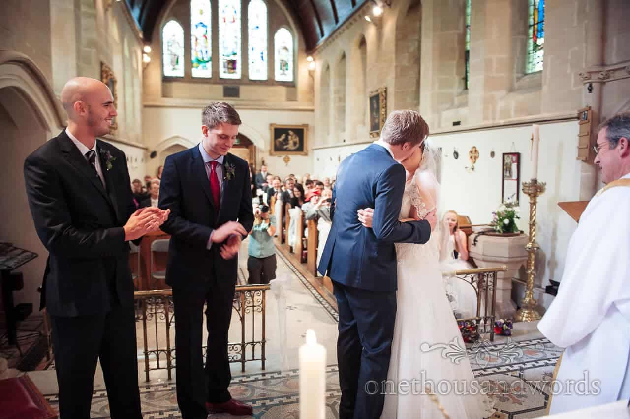 Bride and groom kiss at Lyndhurst church wedding ceremony