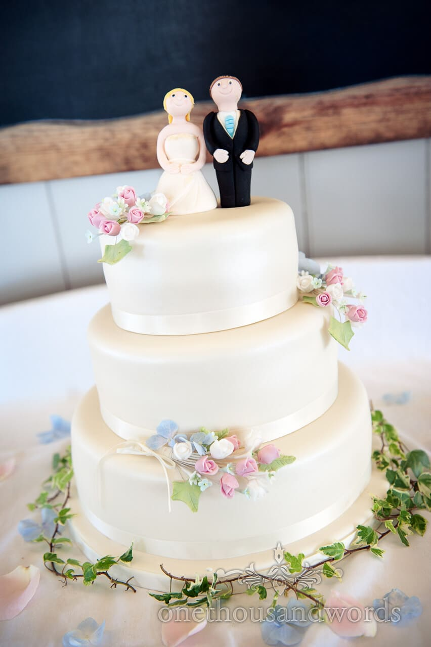 Bride and Groom on wedding cake with icing flowers