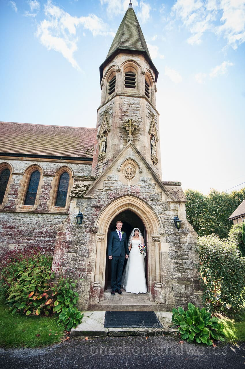 Bride and groom outside St Edward the Confessor Church, Lyndhurst