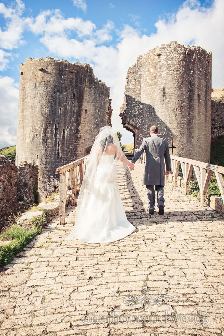 Bride and Groom walk into Corfe Castle on Wedding day