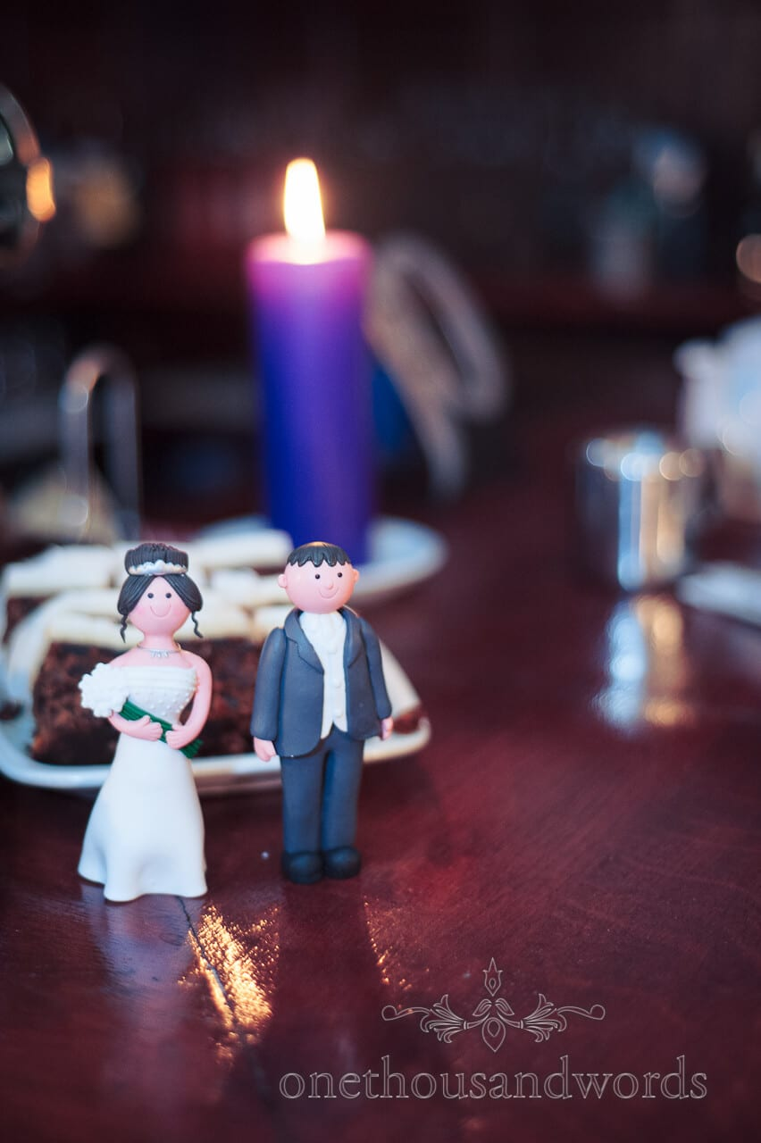 Bride and Groom wedding cake toppers at Corfe Castle Wedding