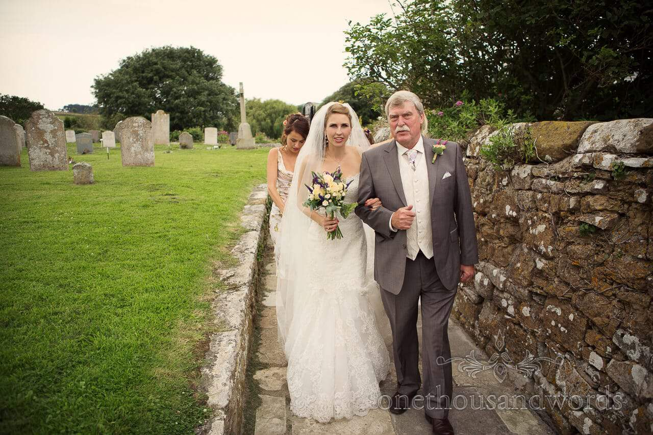 Bride arrives at Abbotsbury church with her father