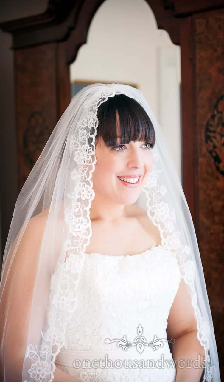 Bride in Long veil at The Crown Manor House Hotel Lyndhurst