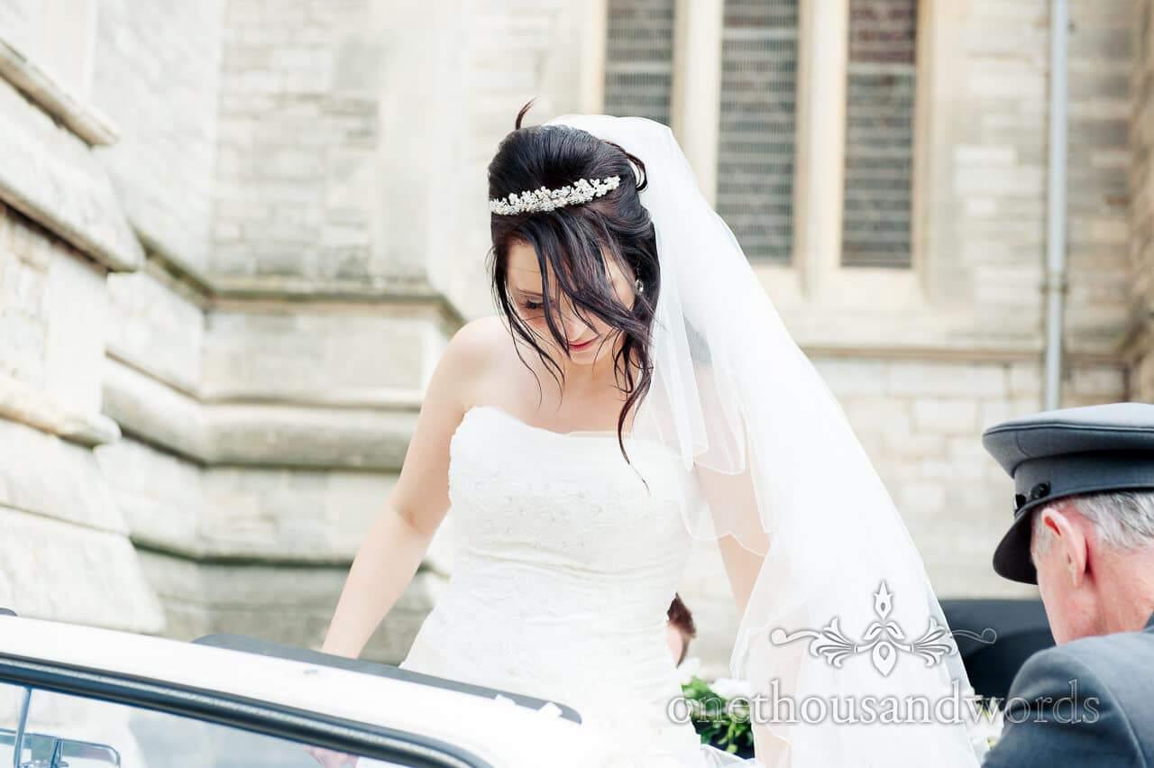 Bride enters wedding car at Bournmouth church wedding ceremony