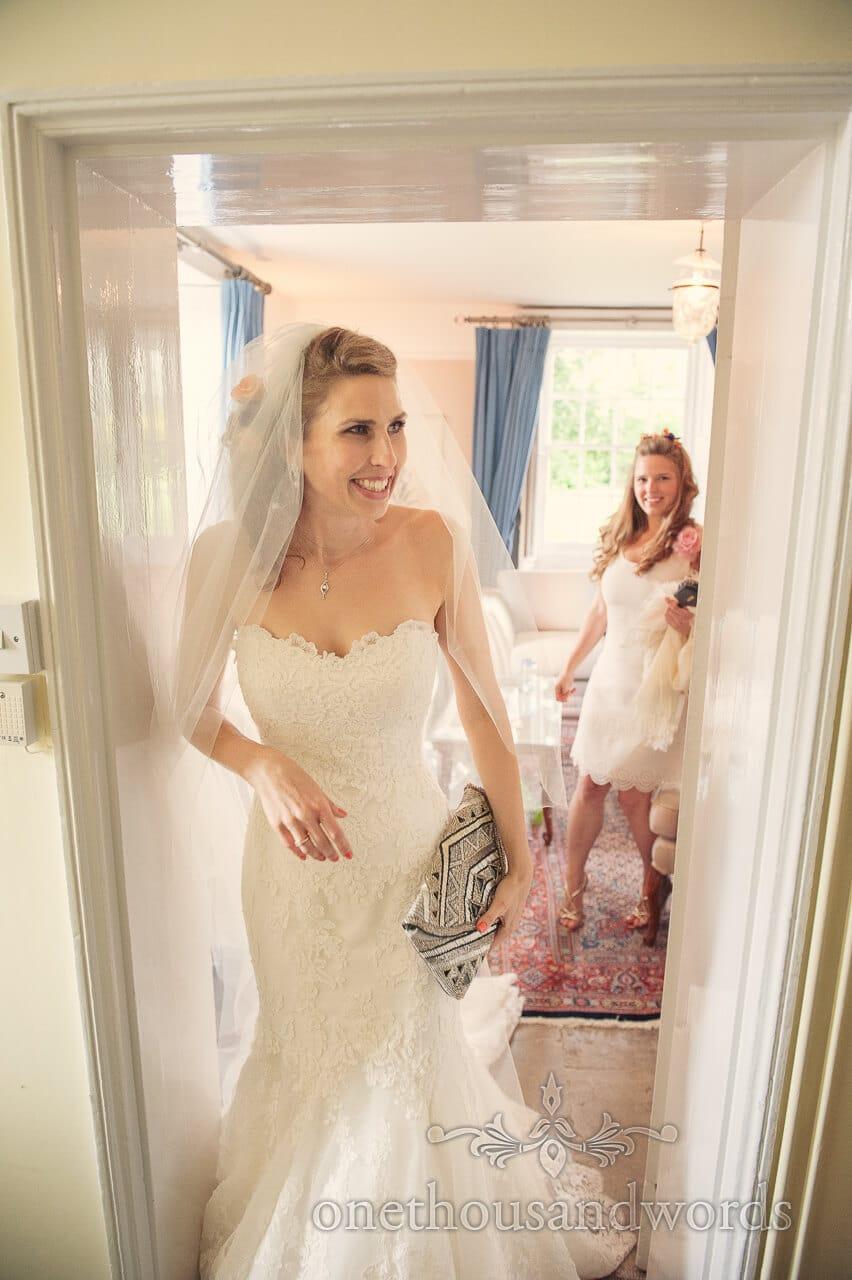 Bride in white wedding dress with clutchbag on wedding morning