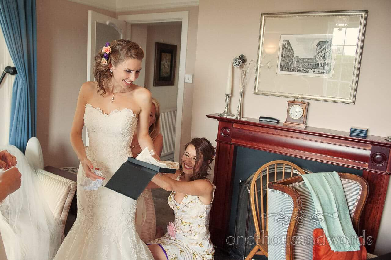 Bride is laced into her wedding dress with wedding garter