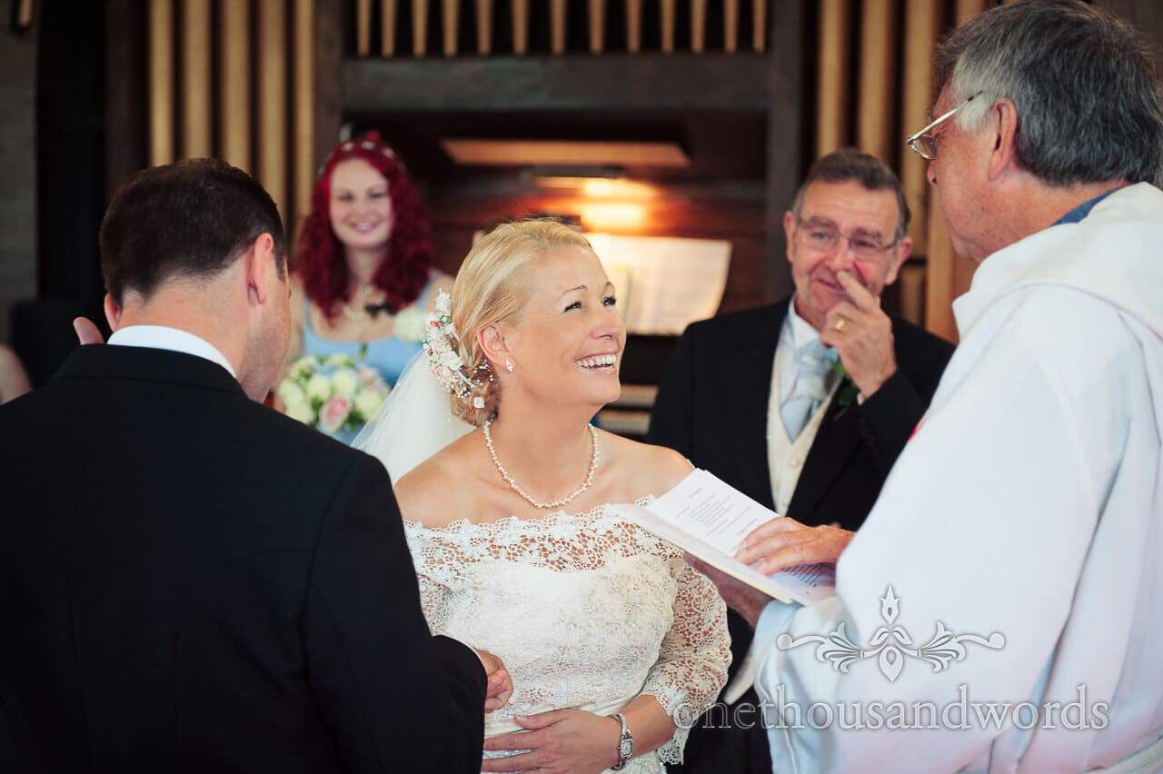 Bride laughing at Church wedding service in Swanage, Dorset
