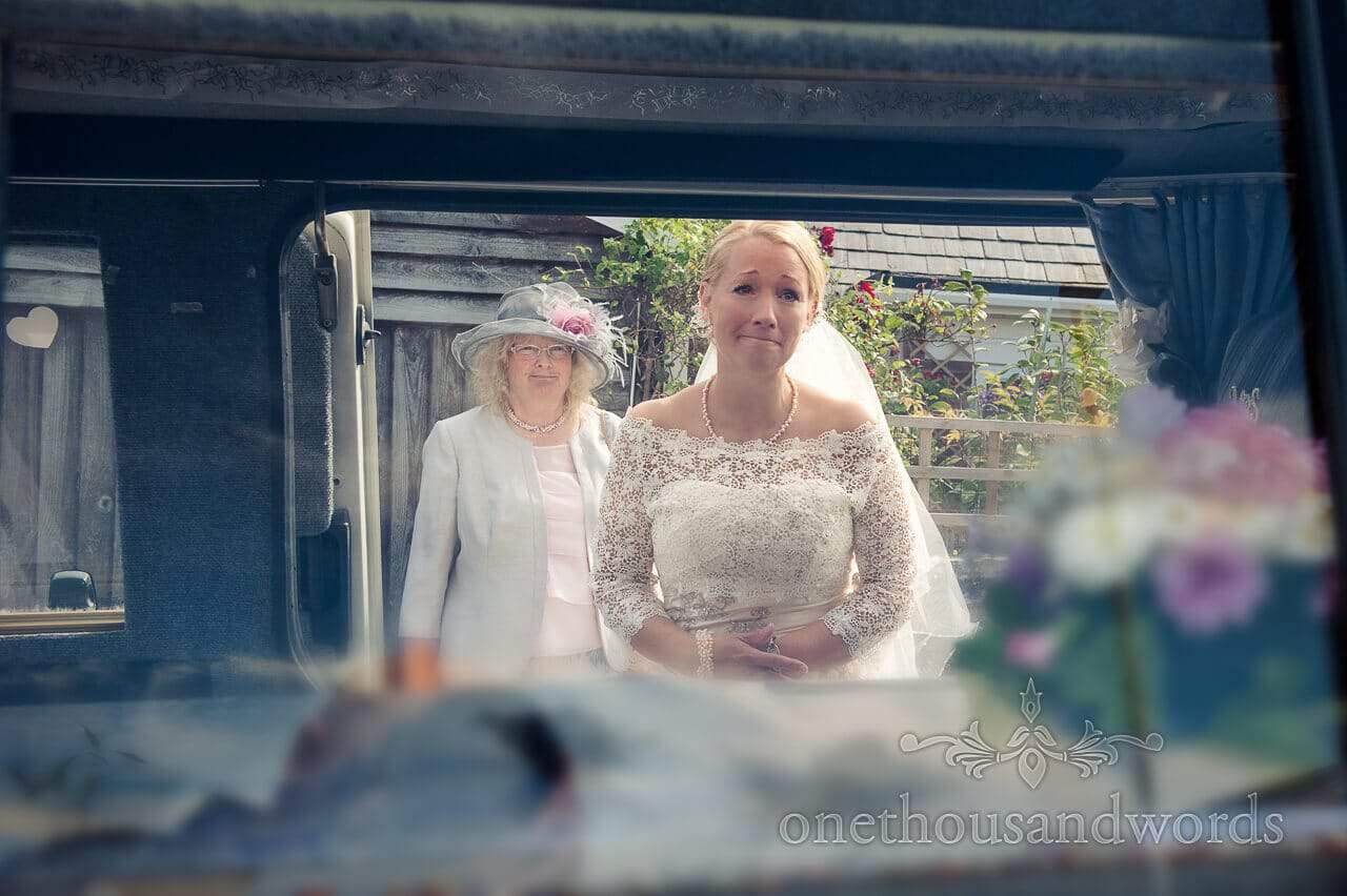 Bride looks at wedding campervan decorations