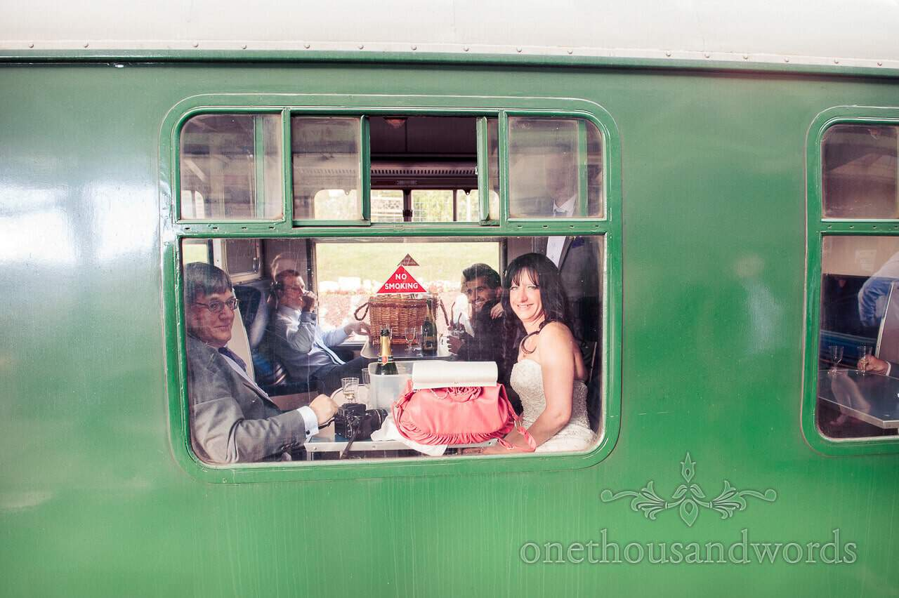 Bride on Swanage Steam Train at Corfe Castle Wedding