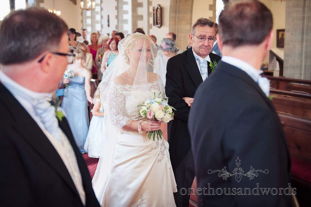 Bride with veil walked up the aisle at Swanage church wedding