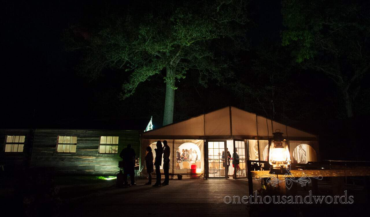 weddings in the wood photographs at night of Carpenters Barn and marquee