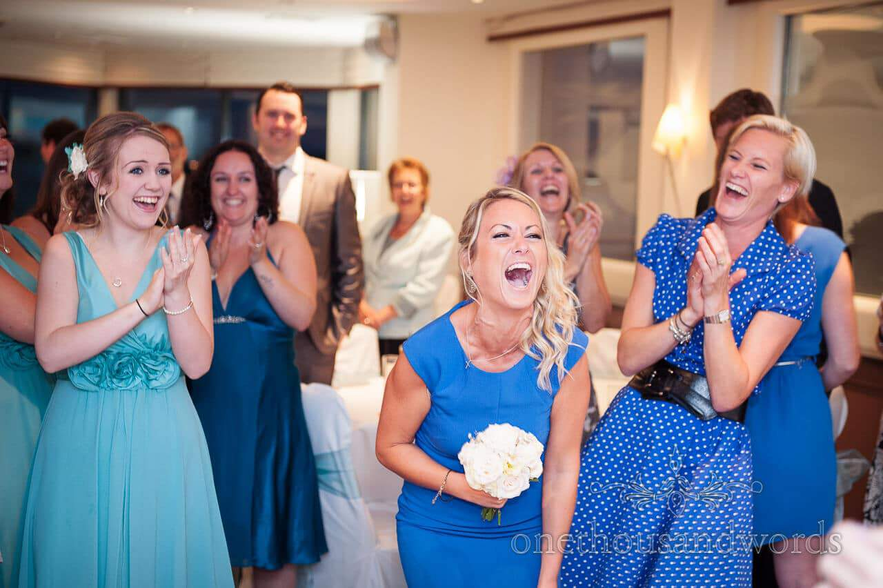 Catching the bouquet at Poole Hotel wedding